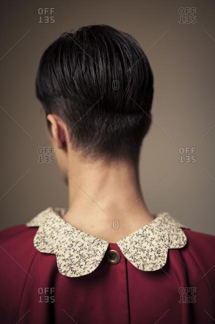 Back of man in puritan collar top