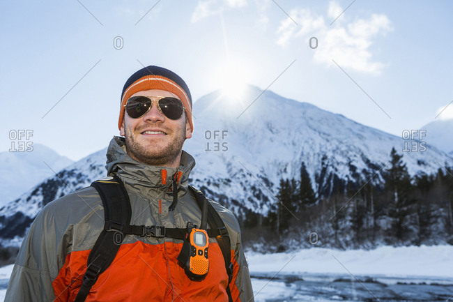 Portrait of young outdoorsy man in a wintery environment