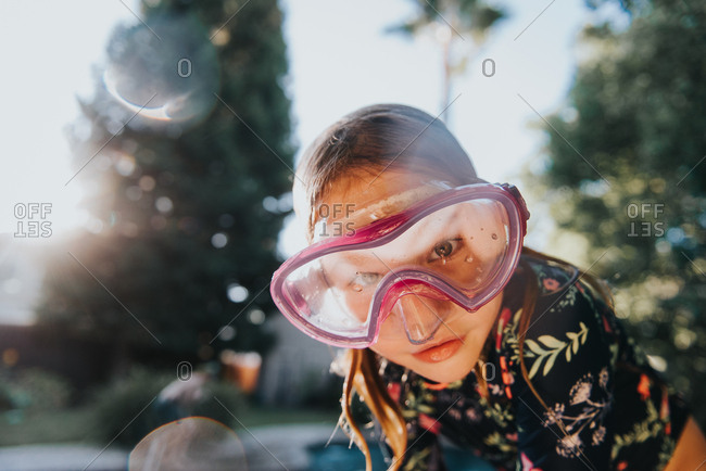 Girl by pool in a snorkel mask