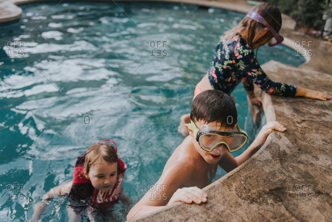 Kids playing in pool in snorkel gear