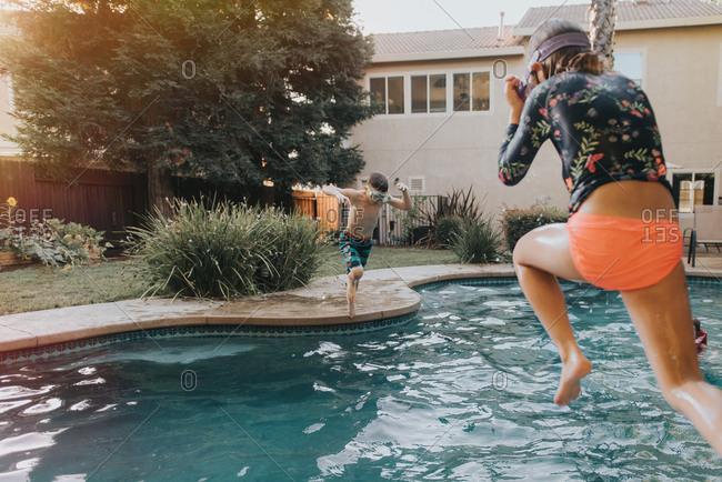 Kids in snorkel masks jumping in pool