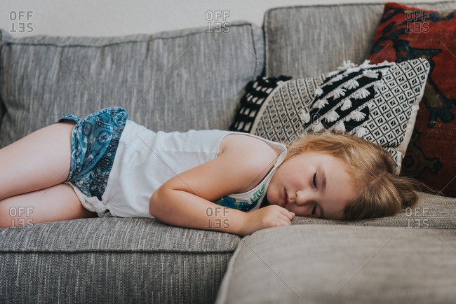 Girl taking nap on a sofa