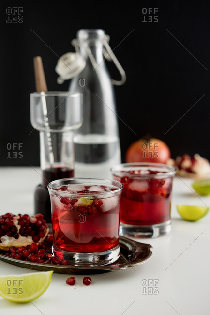A summer cocktail with pomegranate and lime