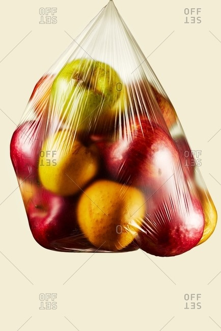Plastic bag filled with various apples
