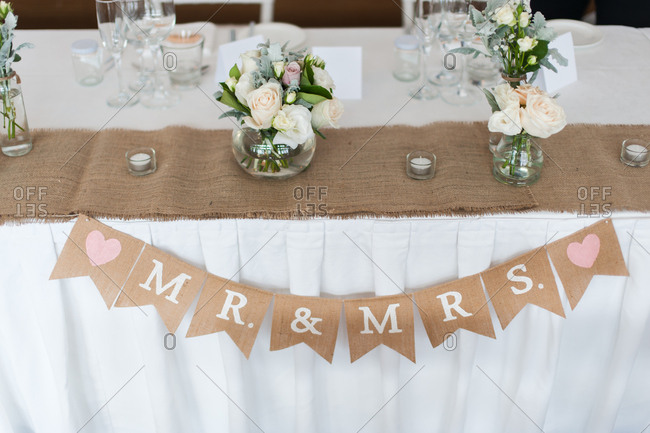 Wedding pennant banner with Mr. and Mrs. on the sign