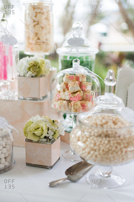 Jars of candy on a table at a wedding reception
