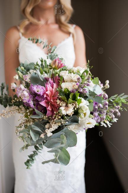 Bride holding a bouquet of native Australian flowers