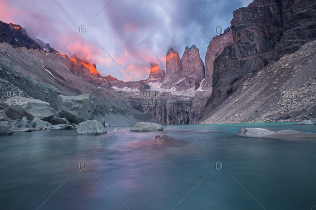 Landscape of frozen lake in basin on rocks and mountains