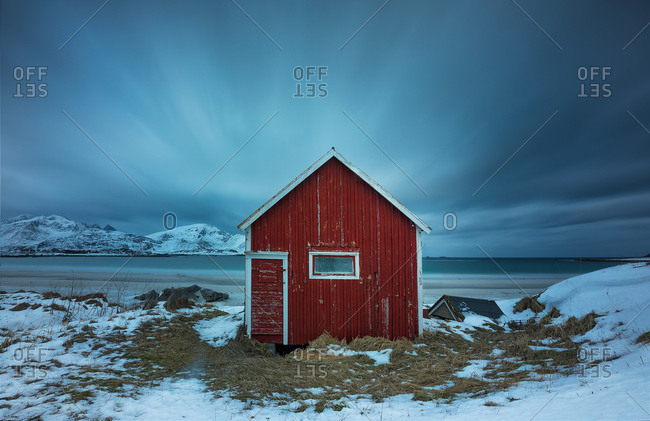 Wooden house at shore
