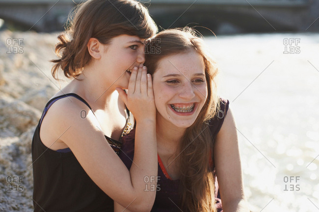 Two girls having fun together in a park
