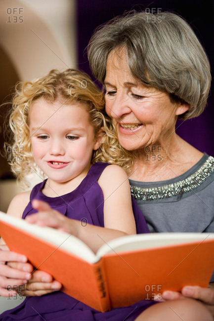 Grandchild and grandma reading book