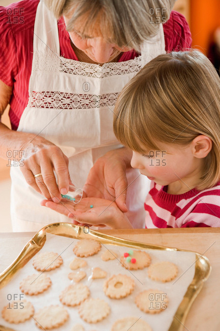 Grandma and grandchild baking biscuits
