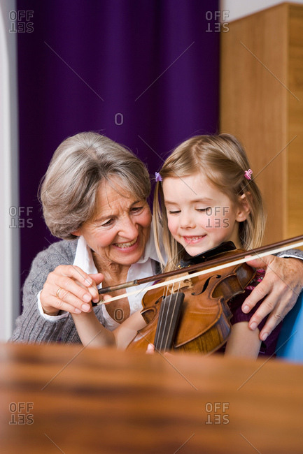 grandma teaching grandchild music