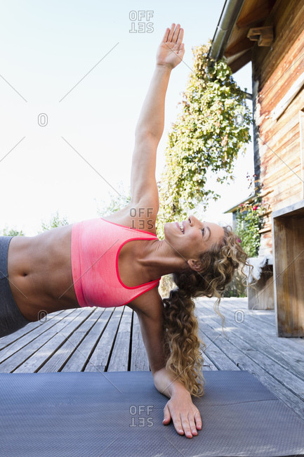 Young woman in side plank pose