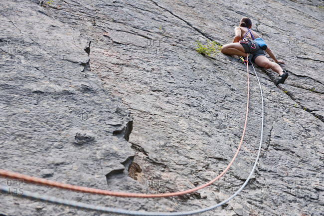 Female climber, lead climbing, Halfway to Kansas at Fairy Cave Quarry