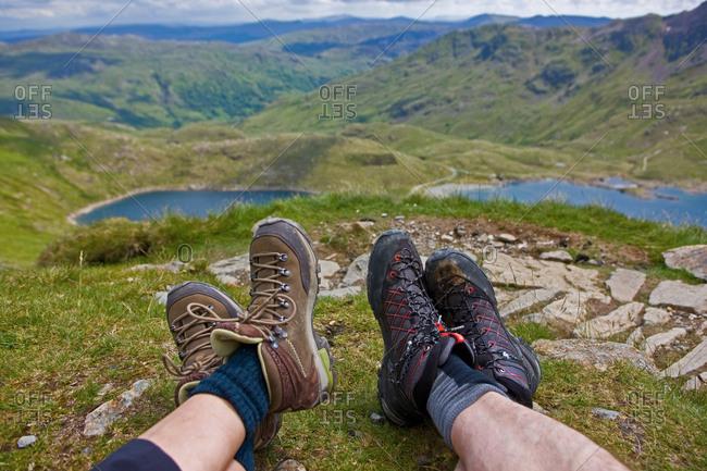 Hiker's shoes overlooking landscape