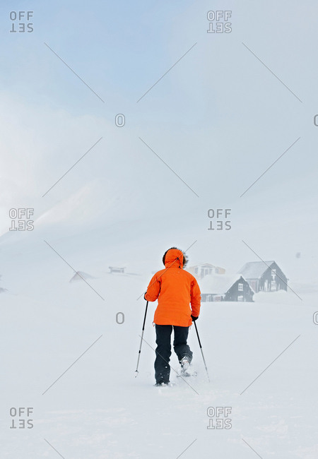 Woman wearing snow shoes, Skidadalur, Dalvik, Iceland