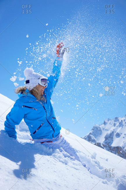 Woman jumping in snow