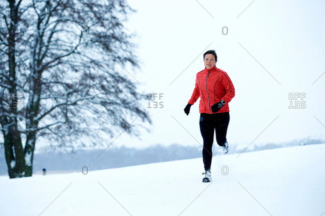 Woman snow running