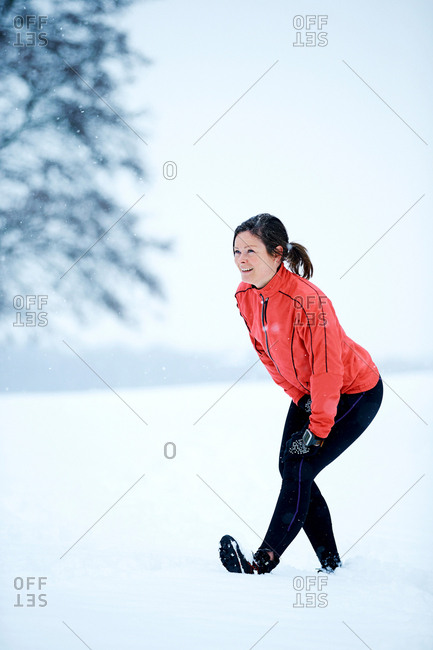 Woman stretching before snow run