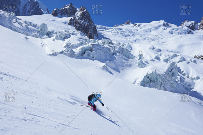 Mature female skier moving downhill on Mont Blanc massif, Graian Alps, France