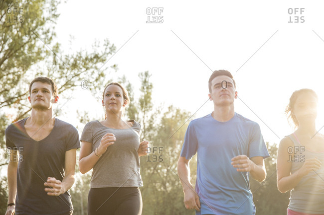 Group of friends running outdoors in rural environment