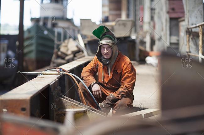 Portrait of welder in shipyard workshop
