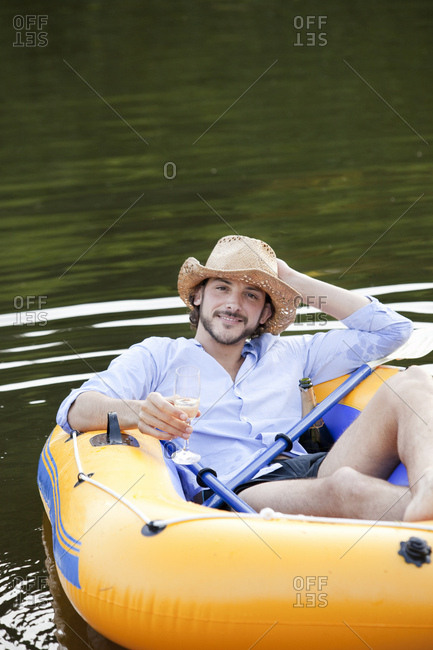 Man in dinghy on a country lake