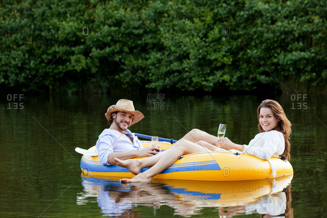 Couple in dinghy on a country lake