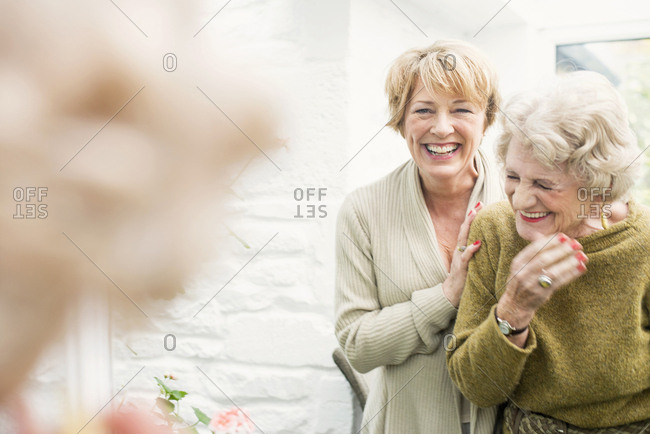 Senior woman with daughter, laughing
