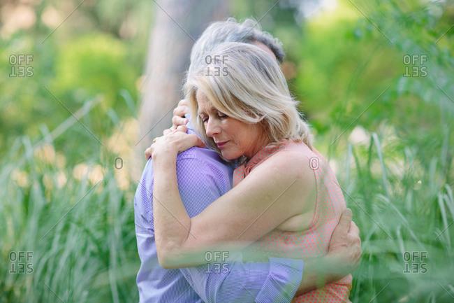 Senior couple, outdoors, embracing