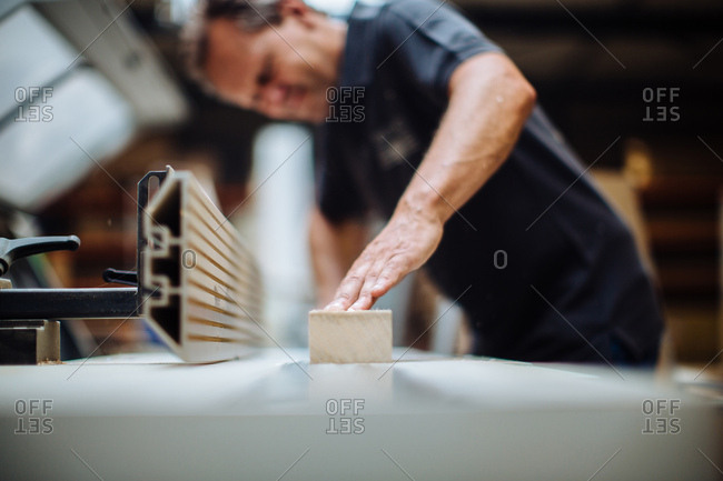 Surface level view of male carpenter at workshop bench