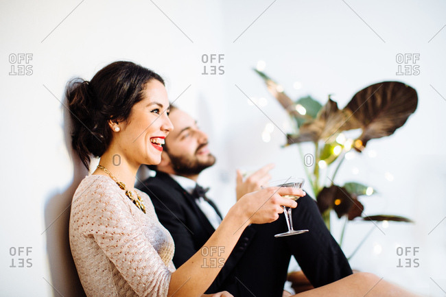 Stylish young couple drinking sparkling wine before night out