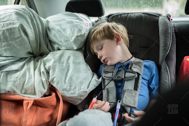 Boy asleep in car seat
