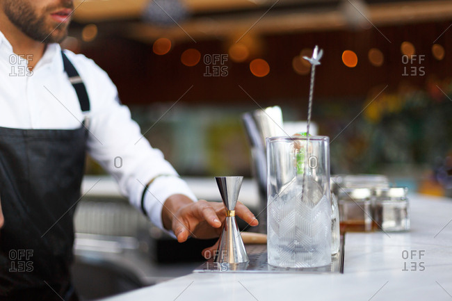 Bartender creating cocktail at upscale bar