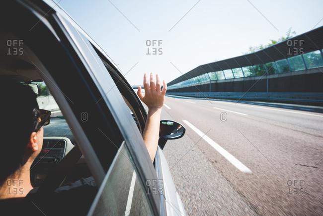 Woman travelling on highway, Garda, Italy
