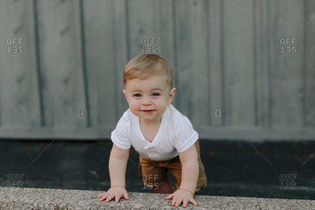 Toddler boy taking a step