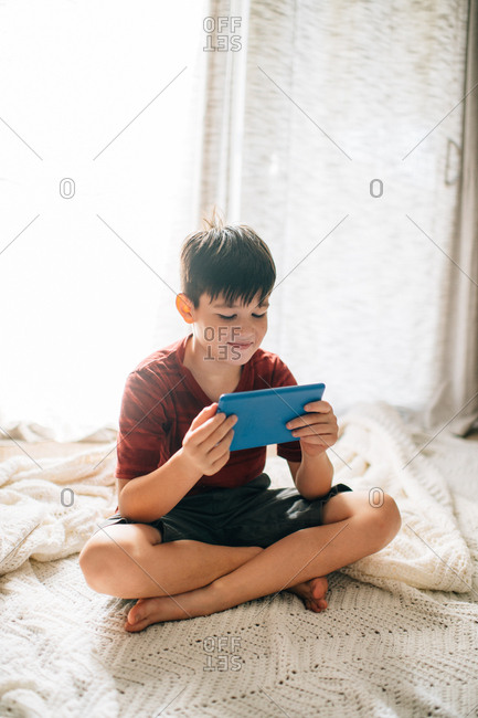 Boy looking at tablet
