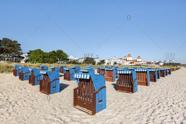 Binz, Germany - May 25, 2016: Beach baskets and Kurhaus, Rugen Island, Mecklenburg-Western Pomerania