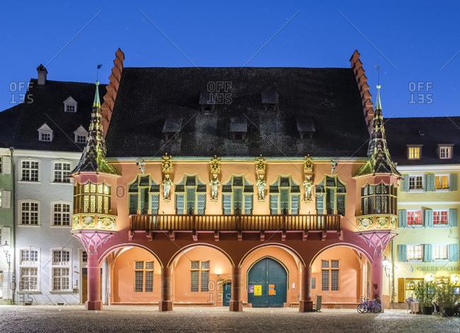 Baden-Wurttemberg, Germany - April 8, 2017: Freiburg im Breisgau. Historisches Kaufhaus (Historical Merchants' Hall) and buildings on Munsterplatz at night