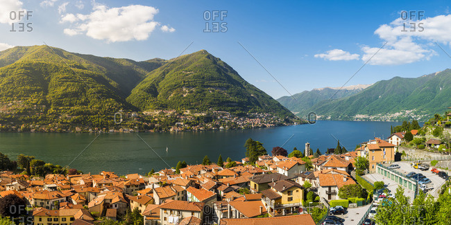 Torno, lake Como, Como province, Lombardy, Italy. Panoramic high angle view of the town and the lake