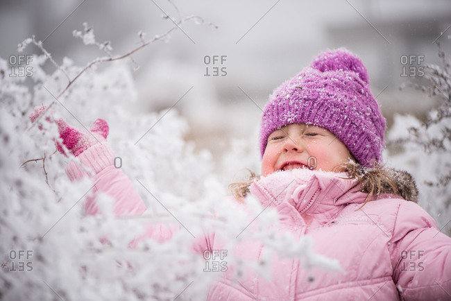 Carefree adorable kid in warm outfit having fun