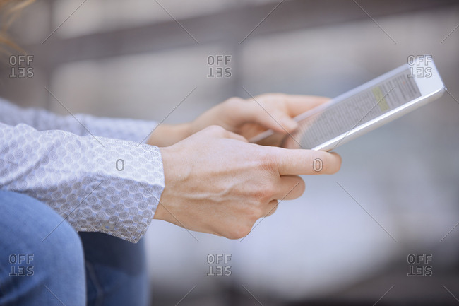 Woman working on tablet computer