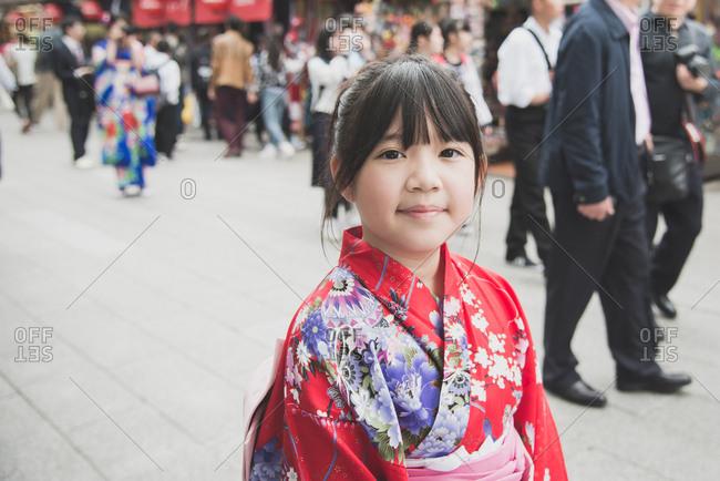 Beautiful Asian girl wearing red kimono walking in the Tokyo Japan