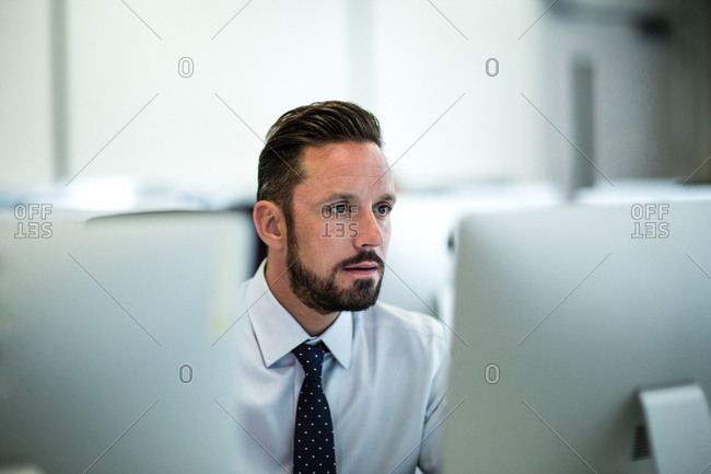 Businessman using computer in empty office