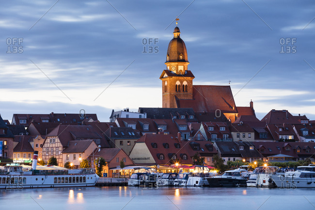 Waren, Germany - July 5, 2017: View to Mueritz- harbour and city at blue hour