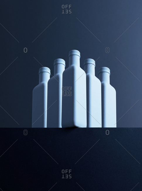 Five bottles in front of dark background- 3D-Rendering