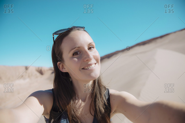 Chile- Atacama Desert- portrait of smiling woman taking selfie