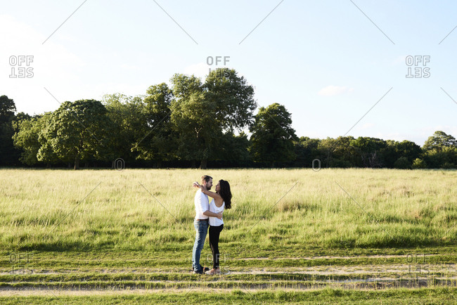 Young couple face to face in nature