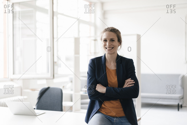 Portrait of smiling businesswoman in  a loft